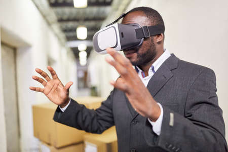 Business man with vision tests VR glasses to simulate the VR factory of the future