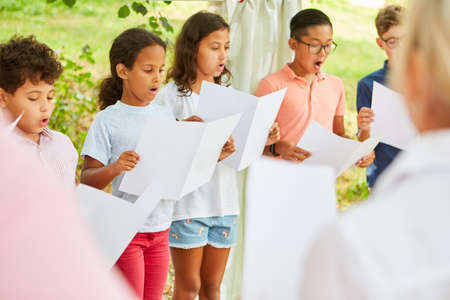 International children's choir sings acappella at the talent show in the summer camp