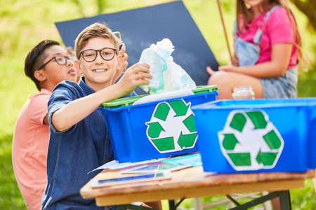 Children learn recycling and environmental protection in an ecological summer camp