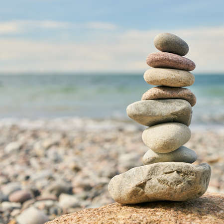 Stones as a stack balanced for Zen meditation on the beach