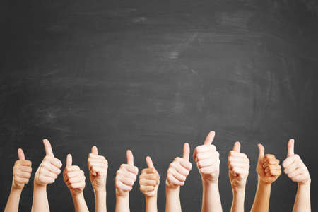 Hands in front of blackboard with like sign Stock Photo
