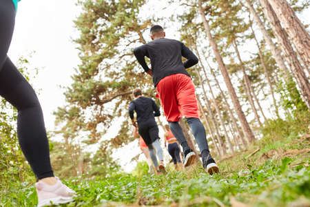 Young people doing cross-country or cross-country runs in nature for fitness and stamina