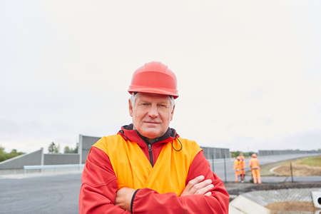 Man as a construction manager or architect with experience of road construction on a construction site