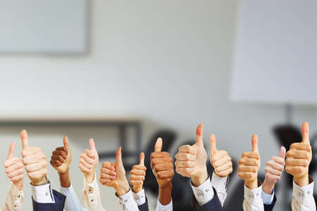 Business people hold thumbs up while working in the conference room 免版税图像