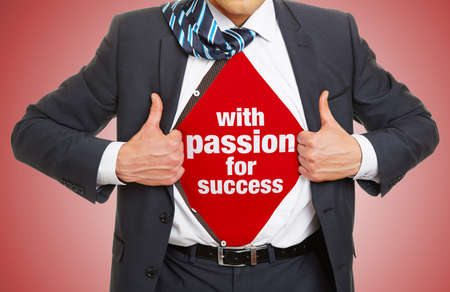 Man in suit opens shirt and wears slogan with passion for success underneath as a concept