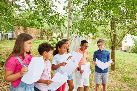 Multicultural children's choir sings a song on the talent show at summer camp