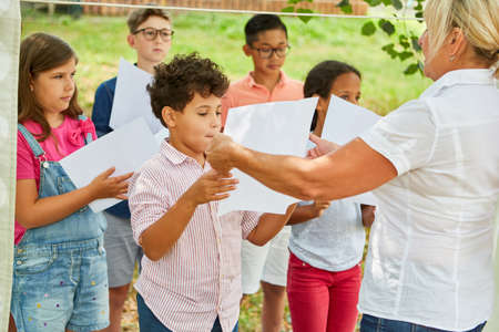 Children's choir at the choir rehearsal with a teacher for the talent show at the holiday camp