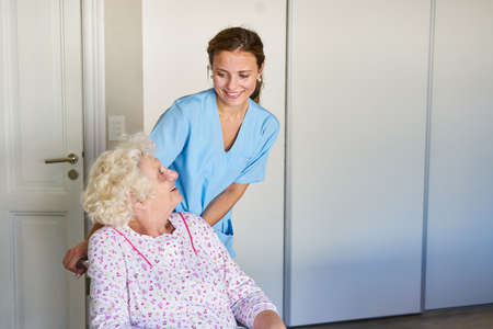 Geriatric nurse takes care of senior citizens in wheelchairs in nursing homes or old people's homes