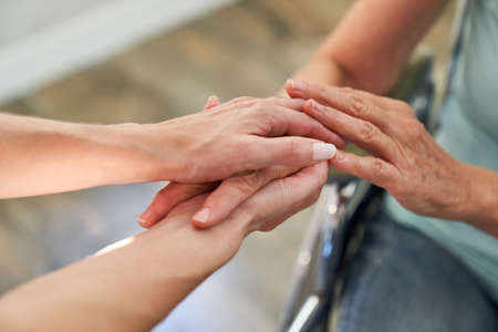 Holding hands as a symbol of comfort and support in bereavement or illness Imagens