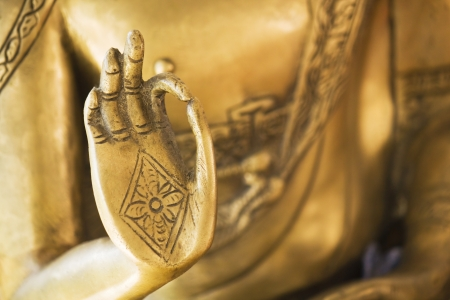 Hand of the golden Buddha