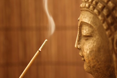 smoke and a buddha sculpture