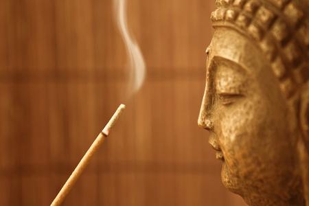 sanskrit: smoke and a buddha sculpture