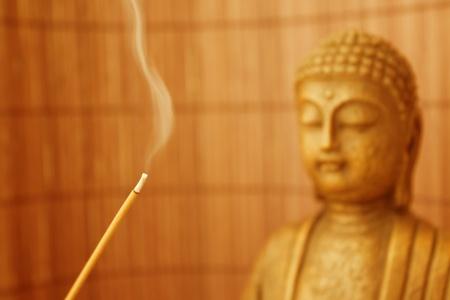smoke and a buddha sculpture photo