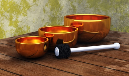reincarnation: golden singing bowls on wood