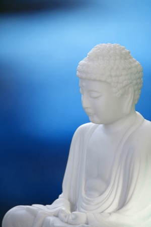 white buddha sculpture and blue background Stock Photo - 8883009