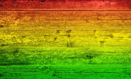 Wooden board background in reggae colors