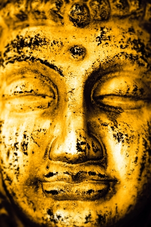 The golden face of the Buddha photo