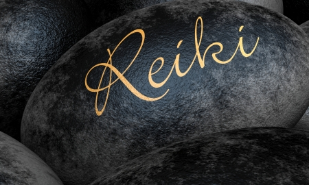 Black stones with text - Reiki Stock Photo
