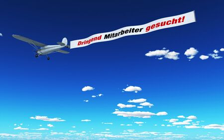 urgently: Airplane Advertising - Urgently looking for employees Stock Photo