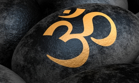 chakra awareness: Black stones with Om symbol - gold