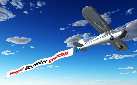 urgently: Airplane Banner - Urgently looking for employees Stock Photo