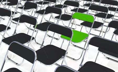 folding chair: A green folding chair into the crowd Stock Photo