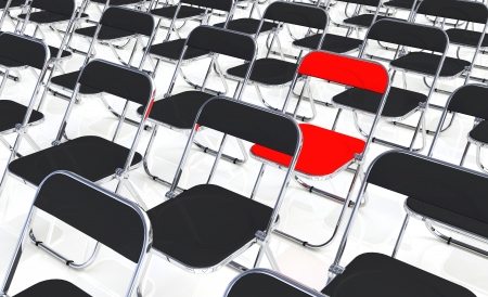 A red folding chair into the crowd Stock Photo - 13945540