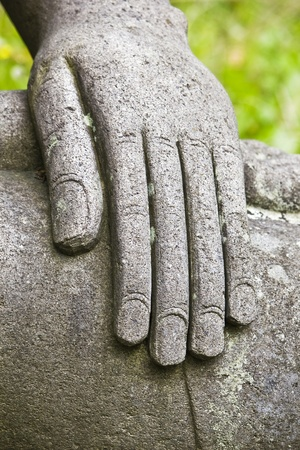 Hand of the stone Buddha photo
