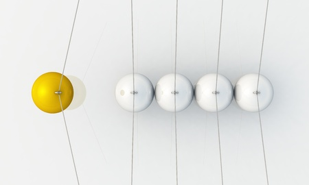momentum: Gold Silver - ball swing - swing from the top Stock Photo
