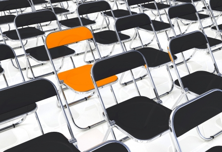 A folding chair in the amount of black and orange photo