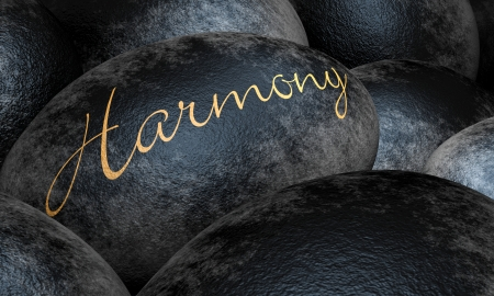 Black stones with text - Harmony
