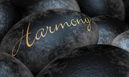 energia espiritual: Piedras negras con el texto - Harmony Foto de archivo