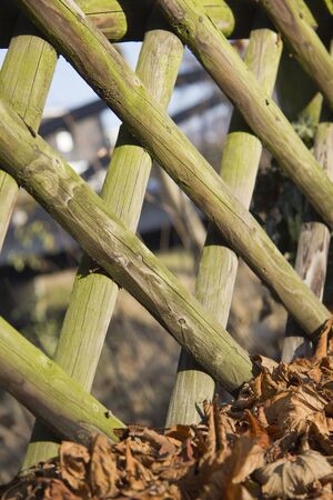 demarcation: Picket fence in autumn Stock Photo