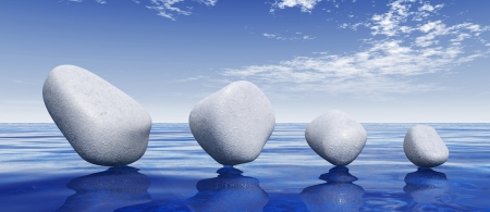 integral: White stones on blue water Stock Photo