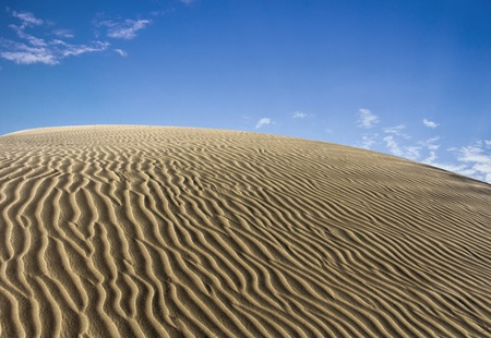 backplate: Undulating dunes with blue sky Stock Photo
