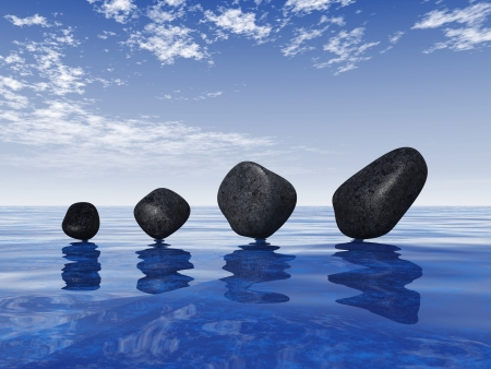 Black stones on blue water 2 photo