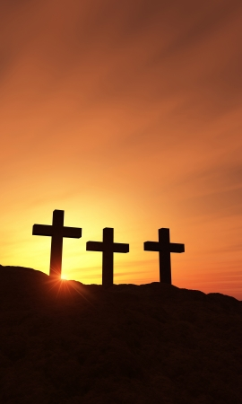 3 crosses on the hill at sunset - vertical photo