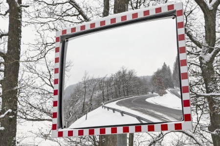 car safety: Traffic mirror the winter Stock Photo
