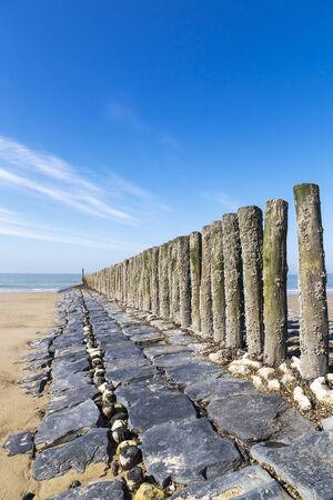 groynes: North Sea beach groynes vertical Stock Photo