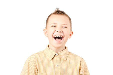 A close-up shot of a boy laughing, isolated on a white Stock Photo - 12425028