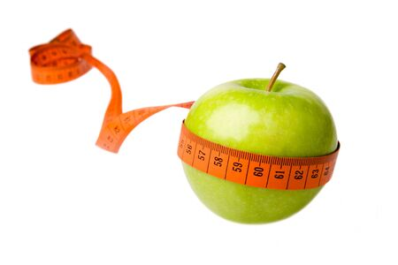 Green apple and measuring tape isolated on a white background Stock Photo
