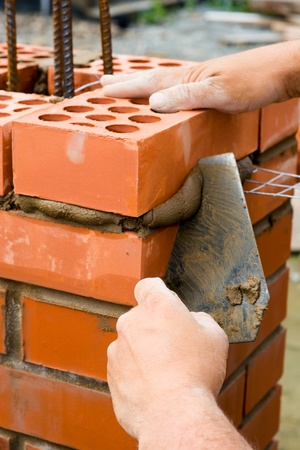 Construction. Bricks laying. Stock Photo - 12721385