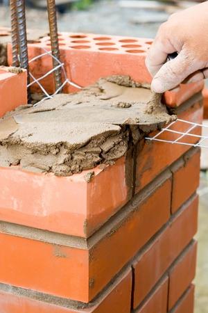 Construction. Bricks Verlegung. Standard-Bild - 12729041