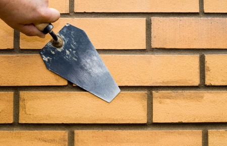 Construction. Bricks Verlegung. Standard-Bild - 12729064