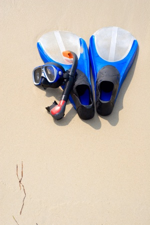 snorkel mask & flippers laying on the wild beach photo