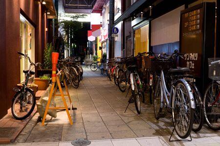 nightscene: Japan, Kyoto, nightscene. Bicycle parking.