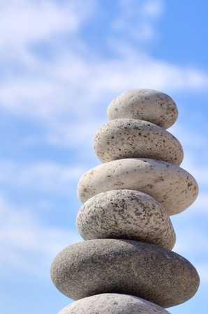stack rock: Round stones on a background of blue sky