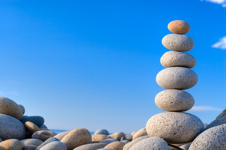 Round stones on a background of blue sky