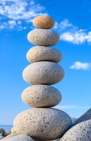 feng: Round stones for meditation laying on seacoast Stock Photo