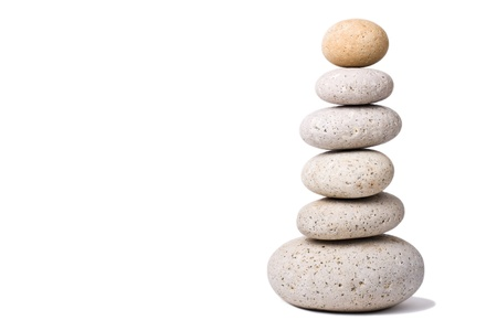 A Stack of Stones on a white Background - a nice Zen-like Background Stock Photo